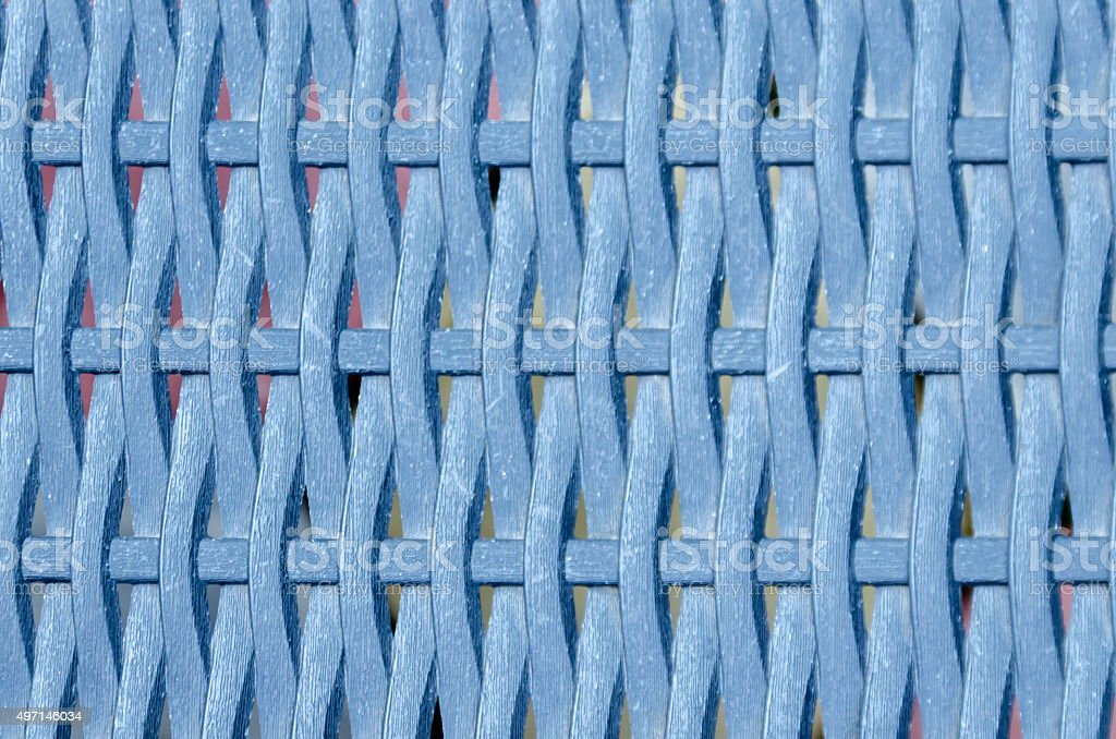 Netlike background wicker with plastic band stock photo