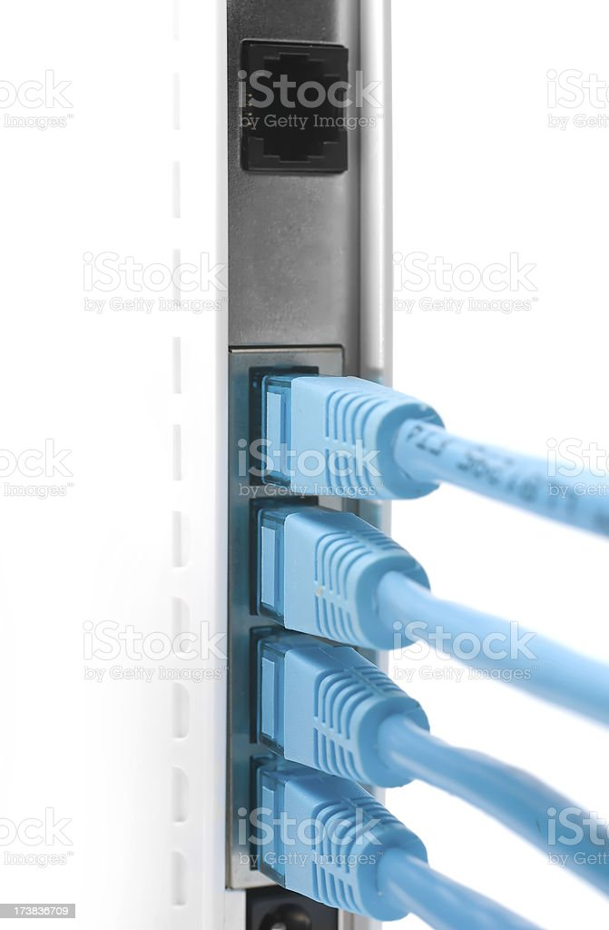 Netowrk cables plugged into a router stock photo