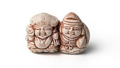 Netsuke of two fishermen with their catch. Isolated.