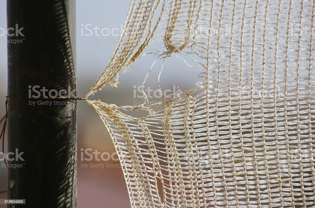 Netting, with a weak, broken string stock photo