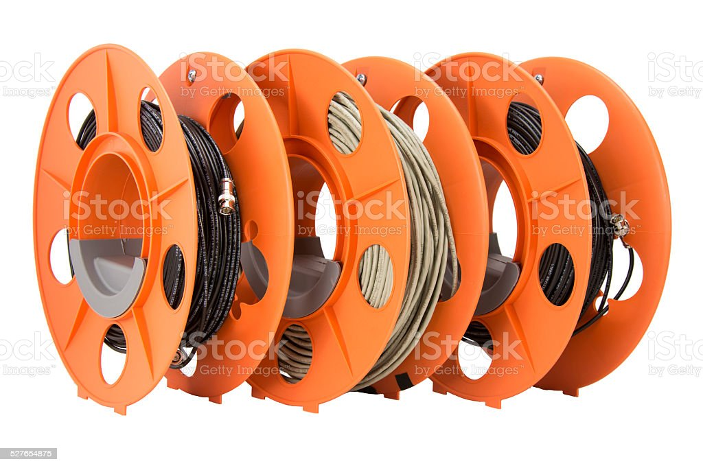 Network and video cables wrapped on orange spools. stock photo