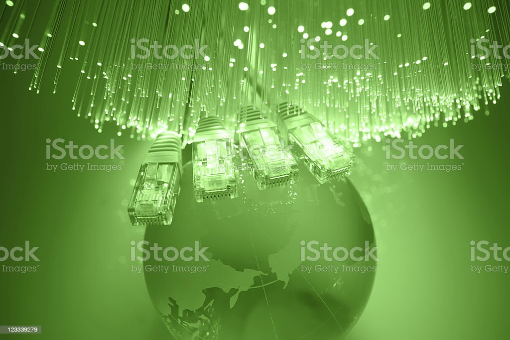 Network cable and global fiber optic royalty-free stock photo
