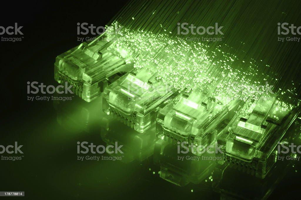 Network cable with Fiber optics light internet concept stock photo