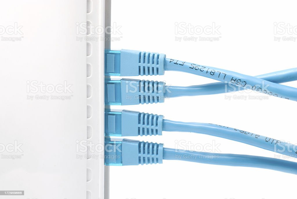 Network cables plugged into the back of router royalty-free stock photo