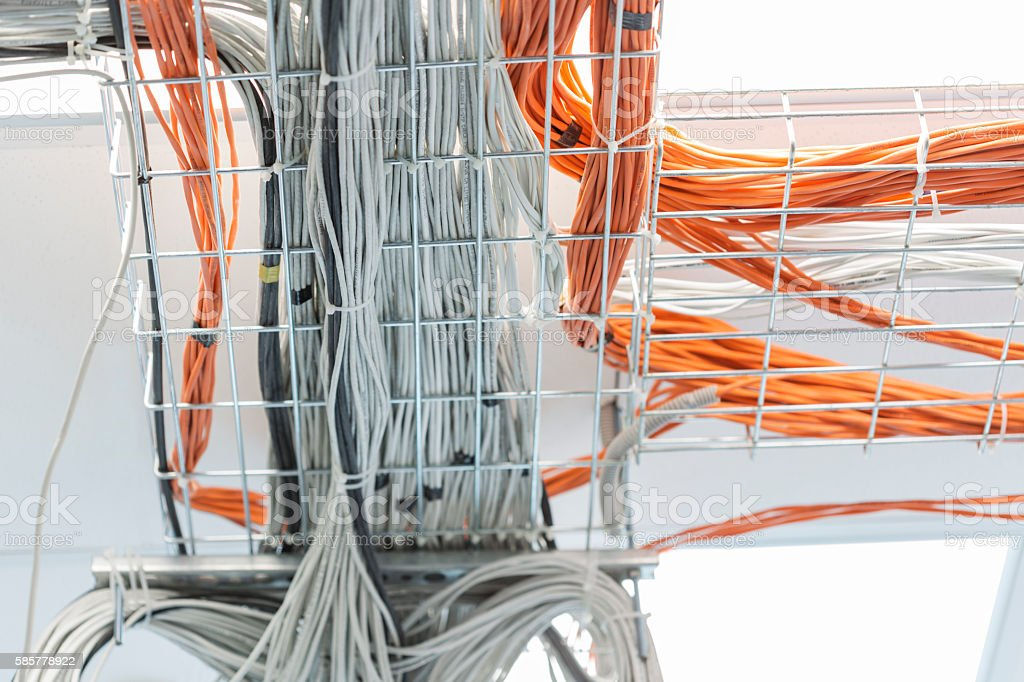 Network communications. Bunch of orange and grey wires stock photo