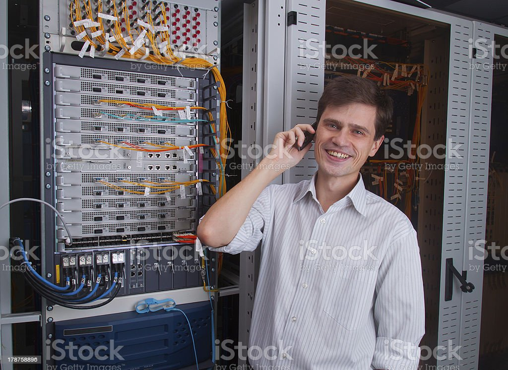 Network engineer in server room royalty-free stock photo