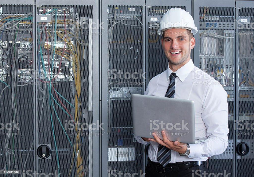 it engeneer businessman with thin modern aluminium laptop in network...
