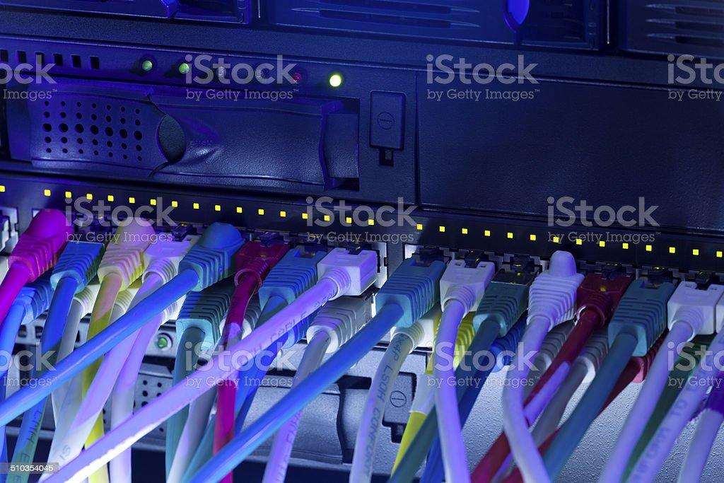Network hub and server rack stock photo