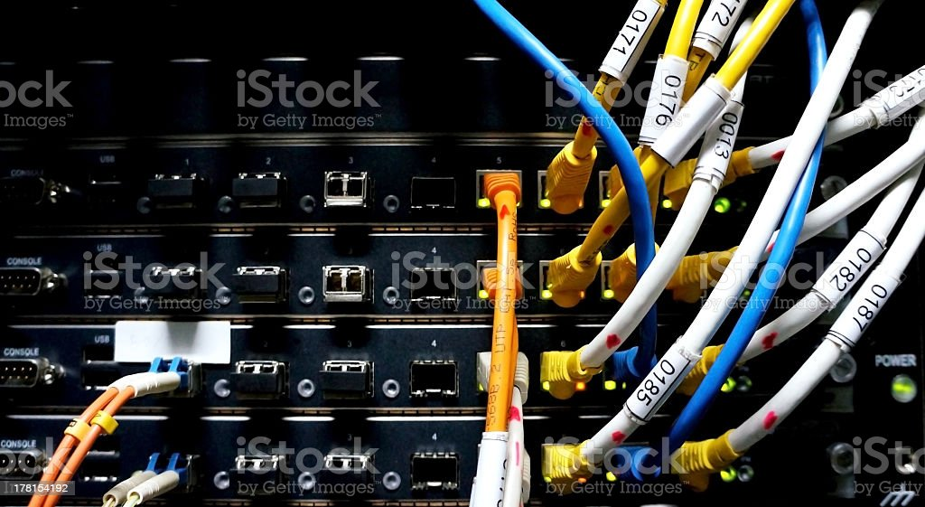 Network hubs with connected cables royalty-free stock photo
