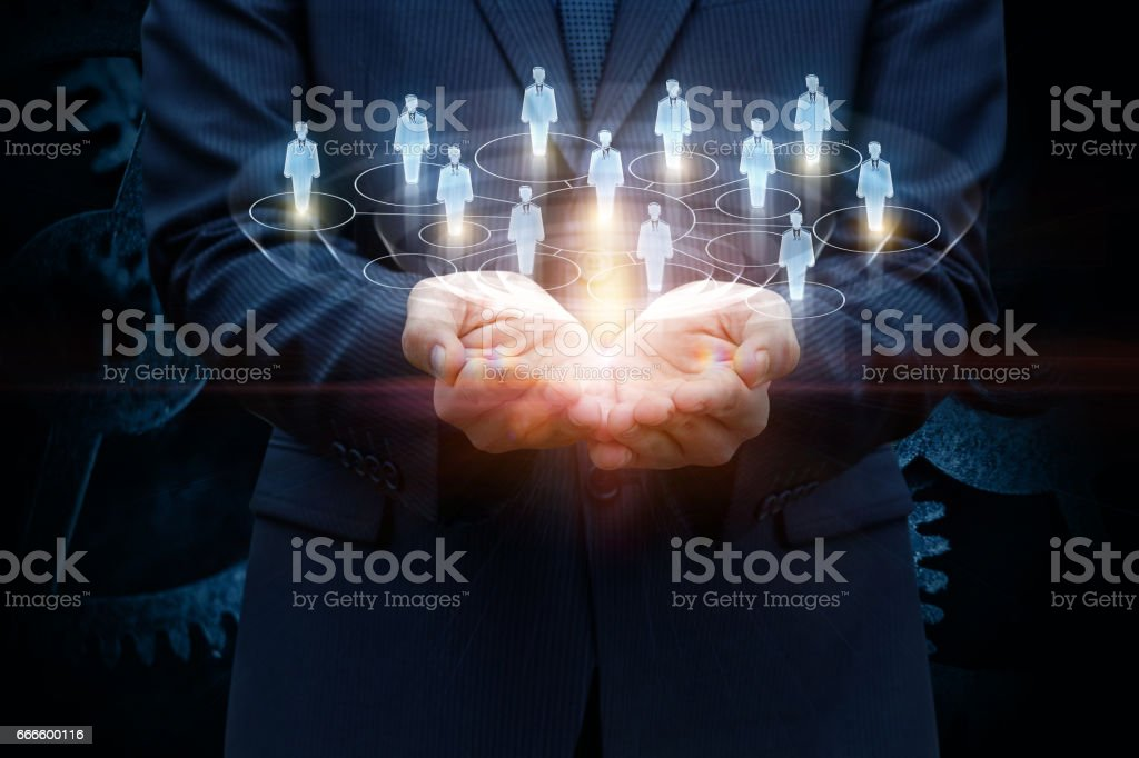 Network of consumers in the hands. stock photo