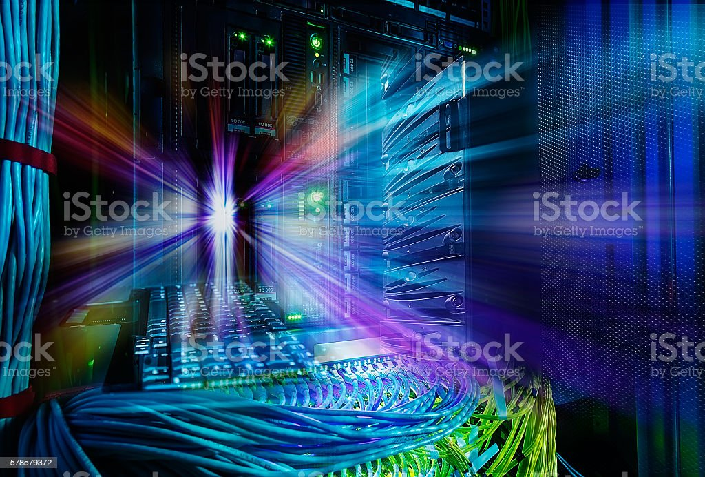 Network switch and UTP ethernet cables close-up in server ro stock photo