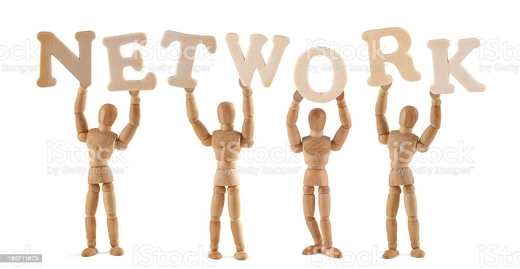 Network - wooden mannequin holding this word stock photo