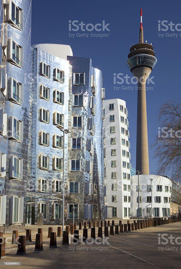 Neuer Zollhof with Rheinturm in Medienhafen, Dusseldorf, Germany stock photo