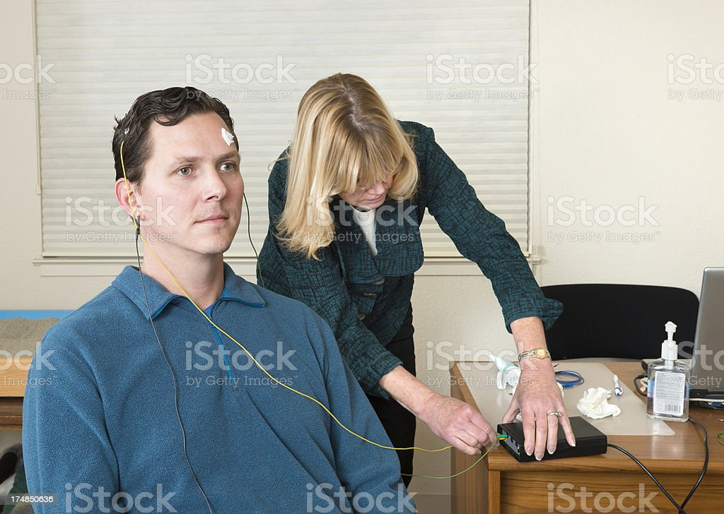 Neurofeedback Doctor and Patient royalty-free stock photo