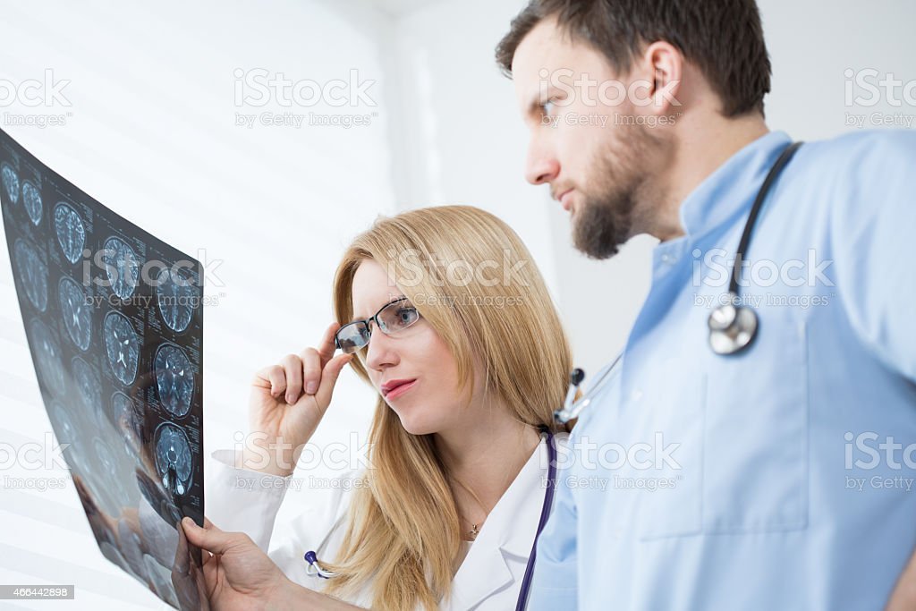 Neurologists reading brain MRI stock photo