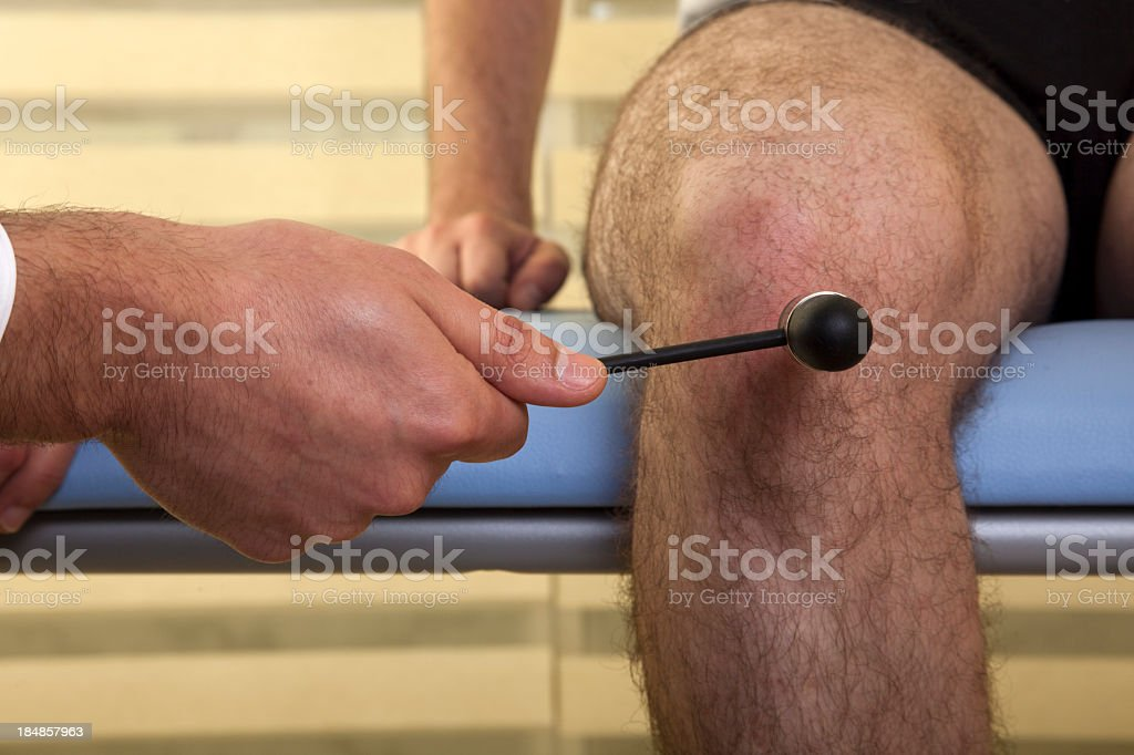 A neuropathologist checking a males reactions stock photo