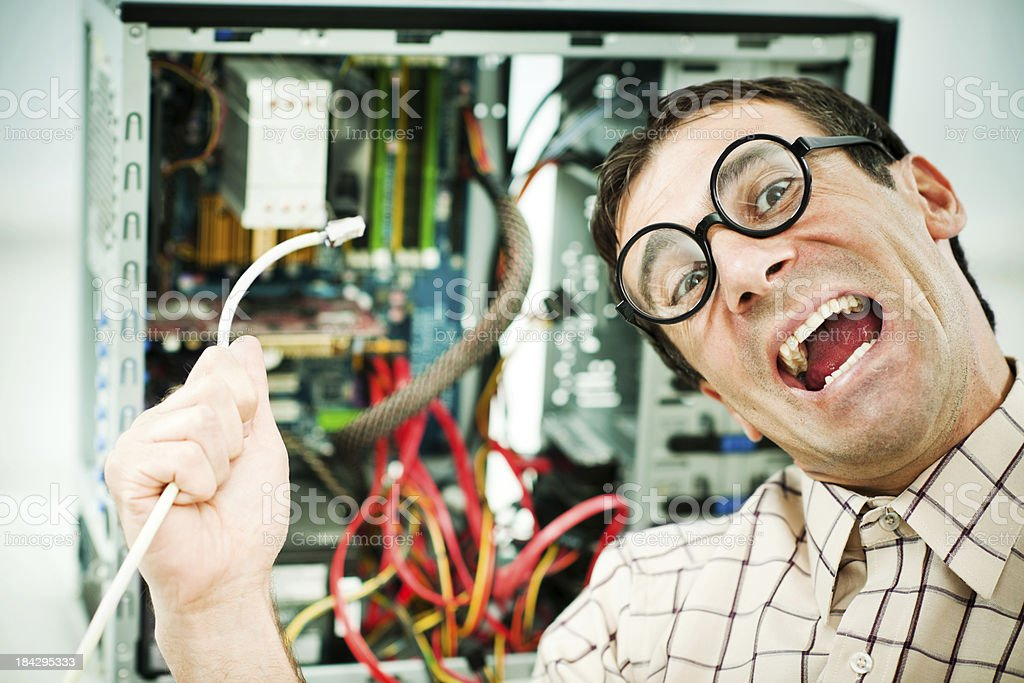 Neurotic male geek fixing his computer. stock photo