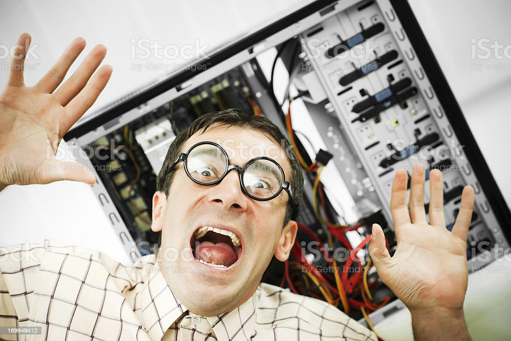 Neurotic male geek screaming. stock photo