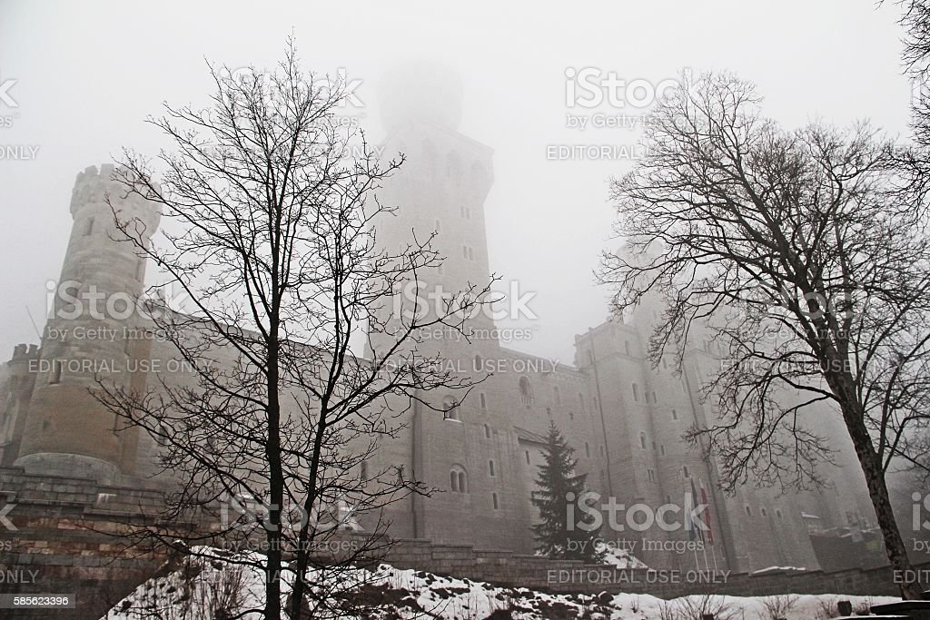 Neuschwanstein Castle in the mist stock photo