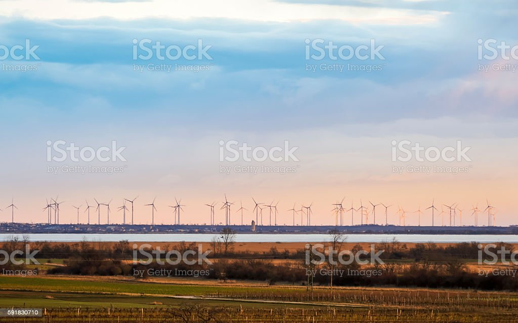Neusiedlersee with windmill park on the eastern shore stock photo