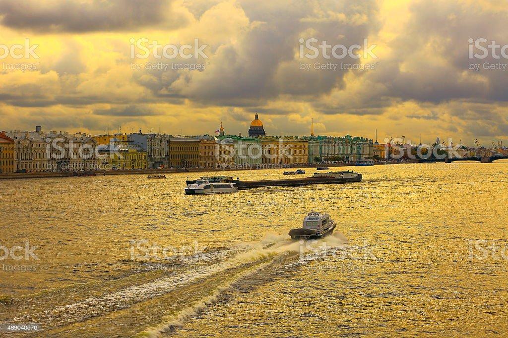 Neva, Hermitage, Russian flag, St. Petersburg skyline dramatic panorama stock photo