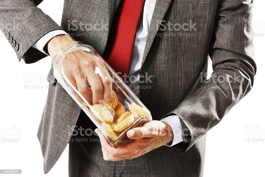 Never mind the diet, I need cookies! Greedy businessman grabbing. royalty-free stock photo