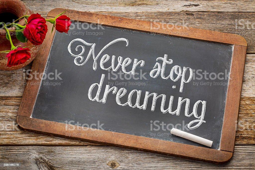 Never stop dreaming on blackboard stock photo