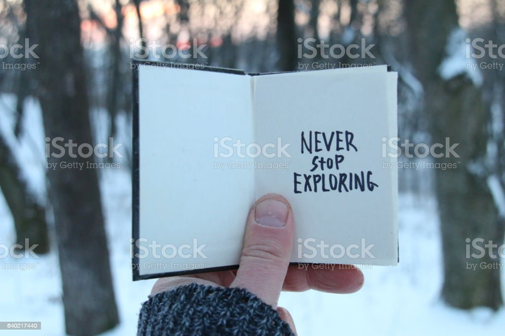 Never stop exploring. Inspirational and motivational quotes. . Book  text. stock photo