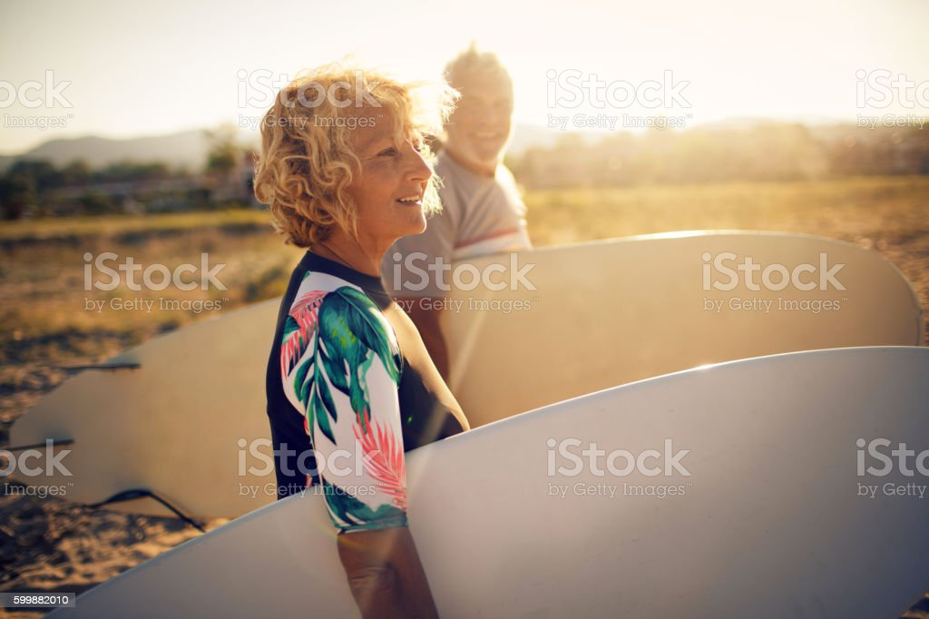 Never too old for surfing stock photo
