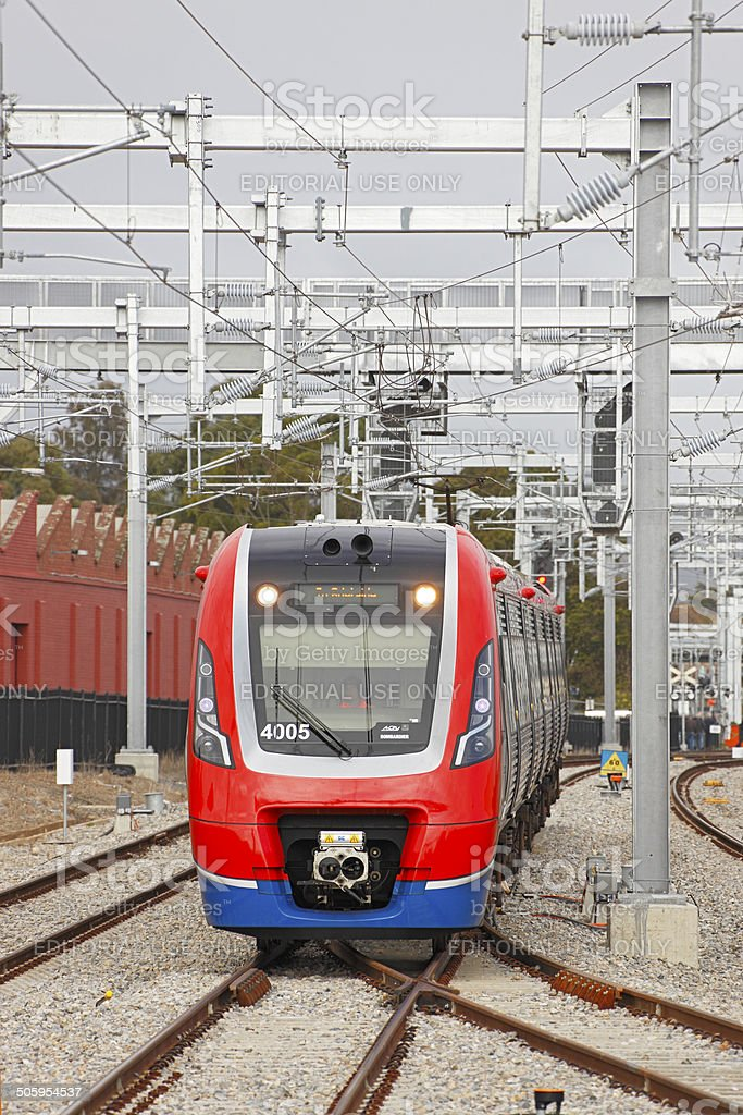 New Adelaide electric train under recently-installed electification stock photo