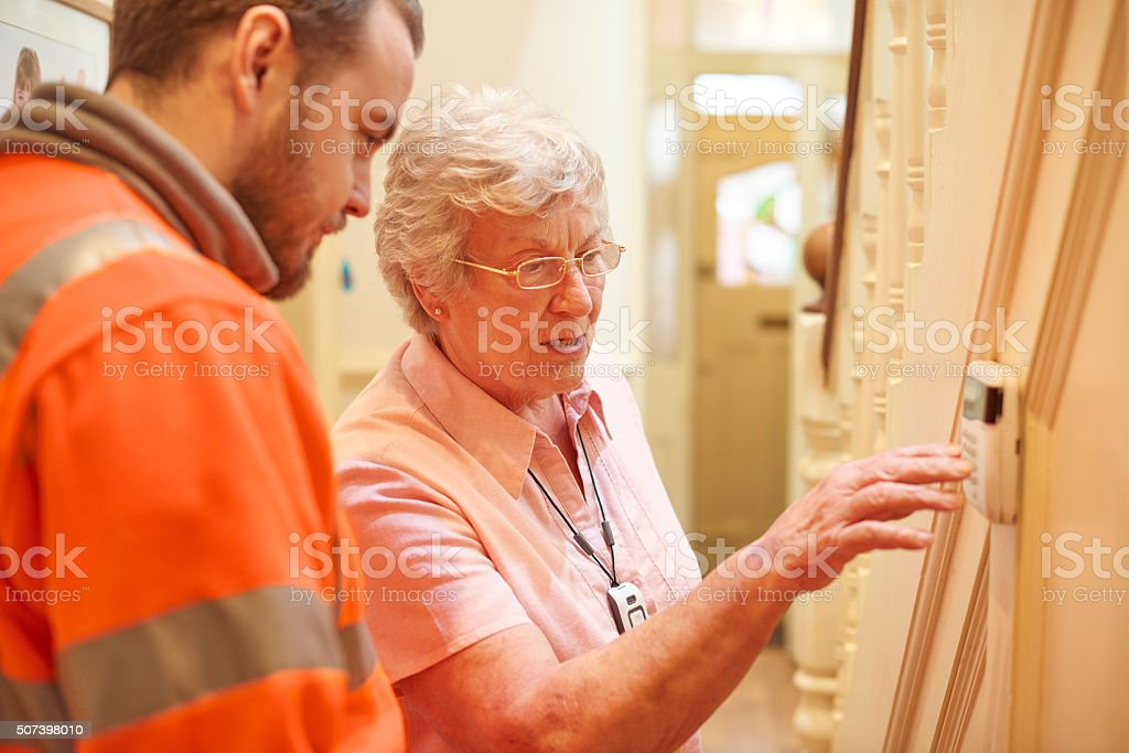 new alarm for senior woman stock photo