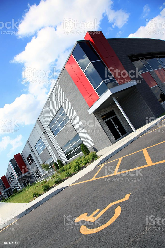 New and Modern Industrial Lofts Building with Handicap Parking Space royalty-free stock photo