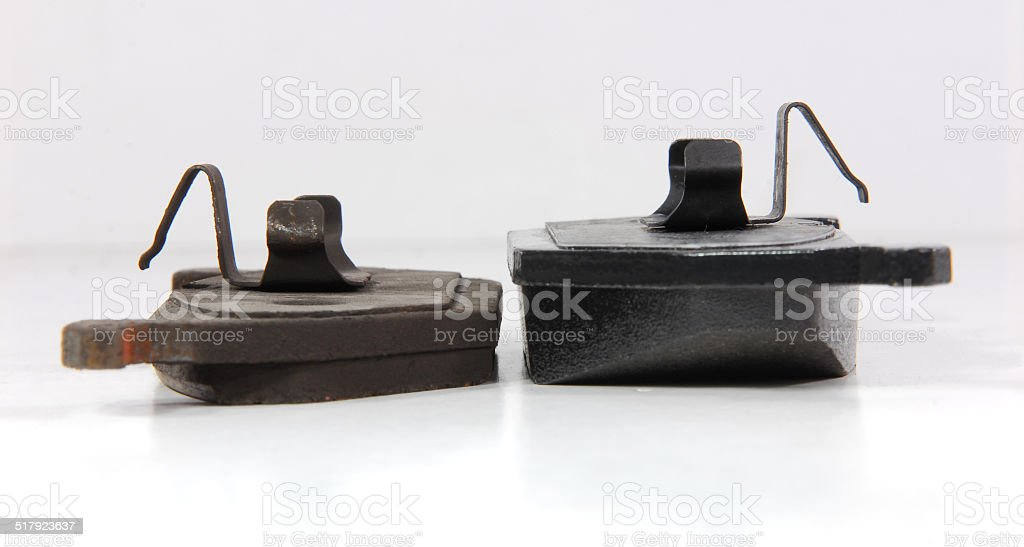 new and old brake pads stock photo