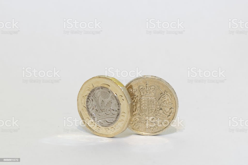 New and Old One pound coin in the UK stock photo