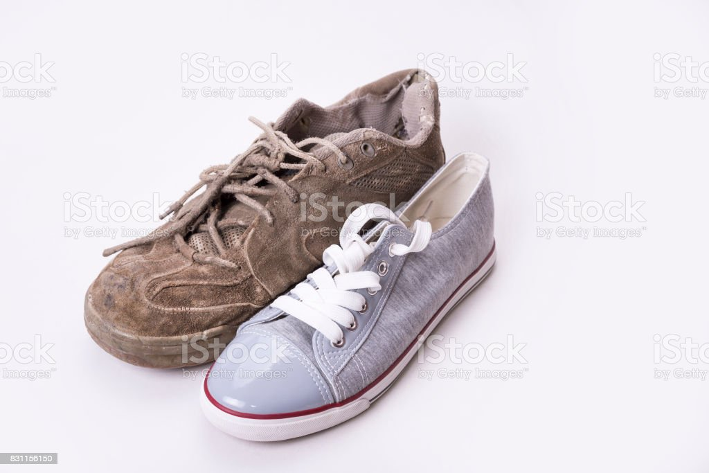 New and old sneaker side by side on white background stock photo