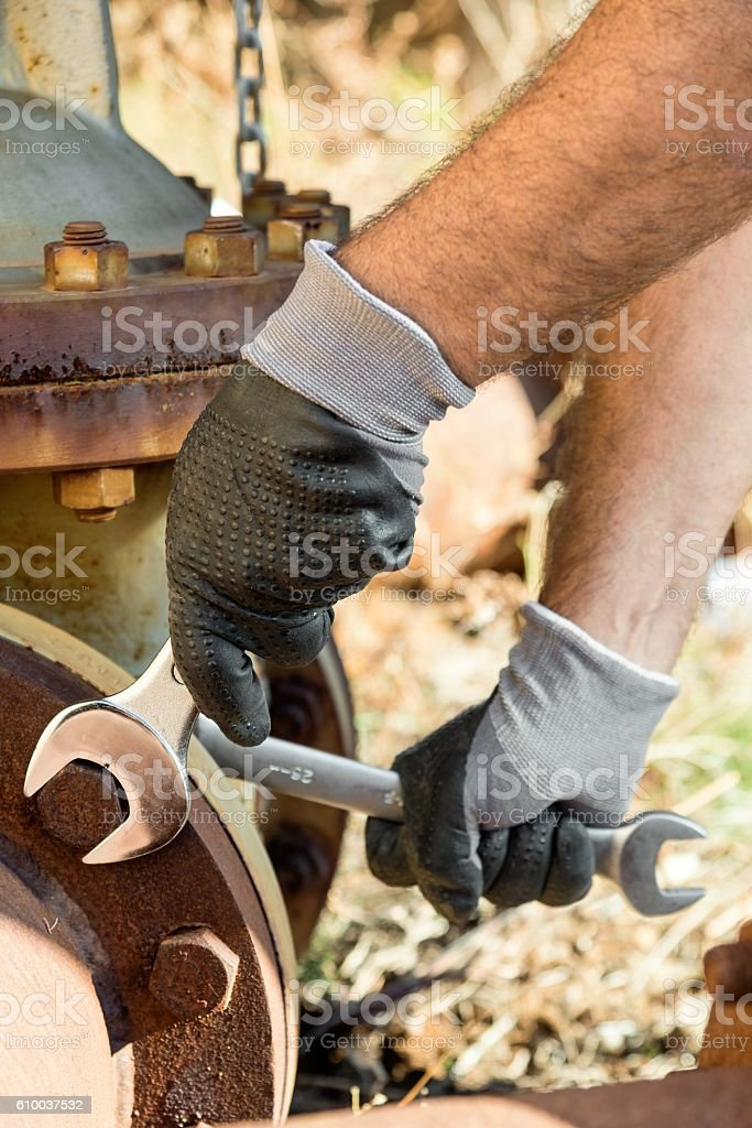 new and shiny spanner wrench to tighten stock photo