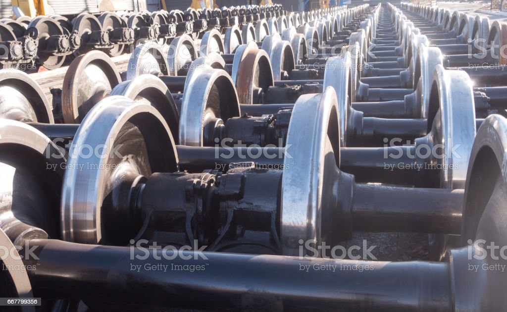 New and spare railway wheels on the axle in a repair workshop stock photo