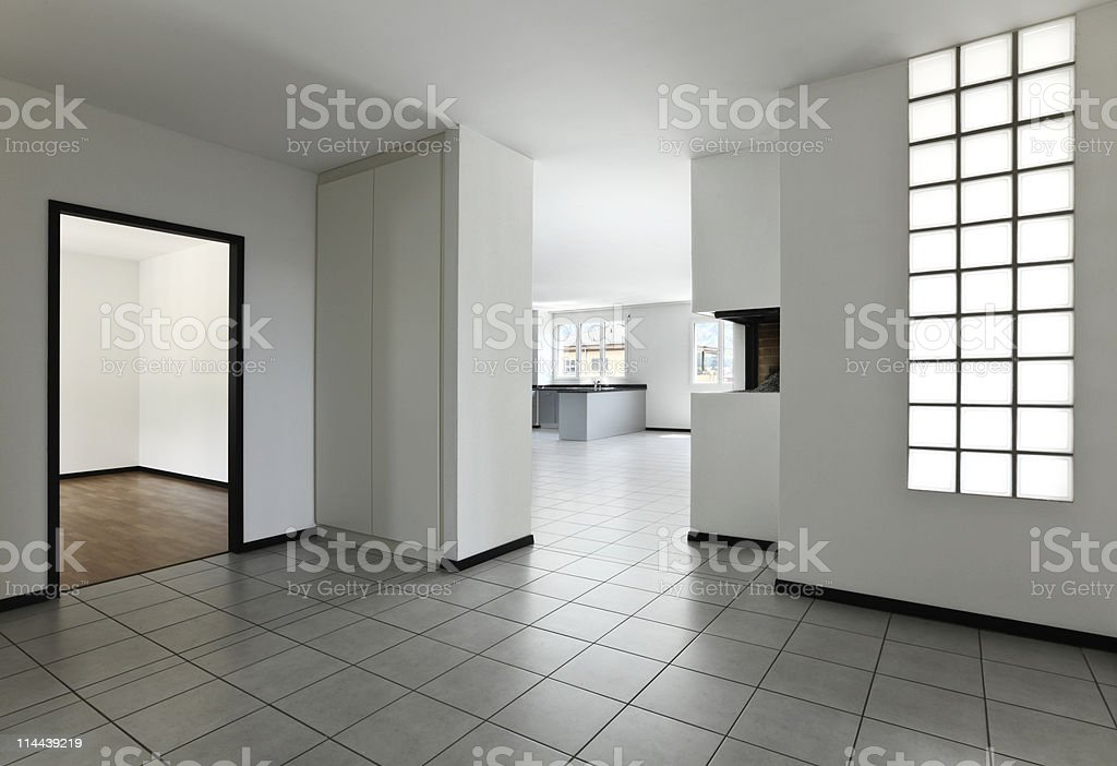 new apartment, empty room with white tiled floor royalty-free stock photo