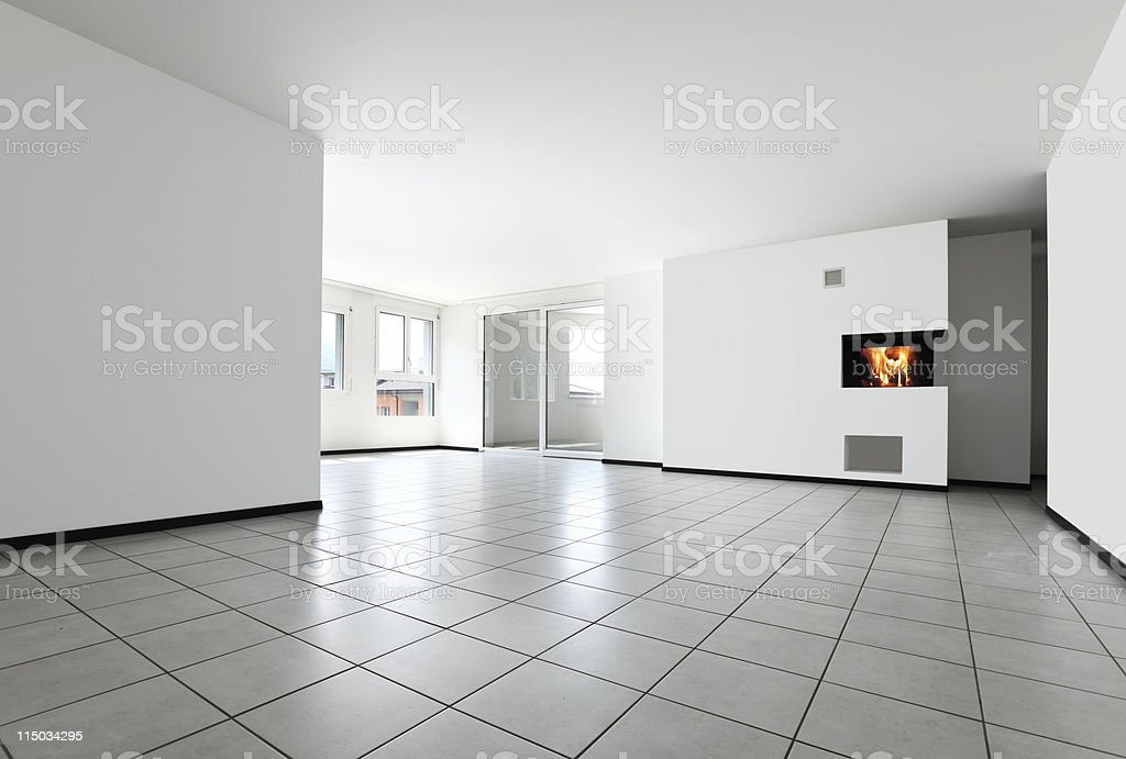 new apartment, empty room with white tiled floor stock photo