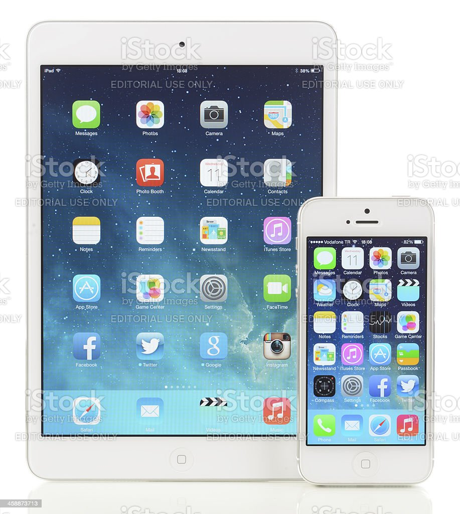 New Apple iOS 7 on iPad Mini and iPhone 5 royalty-free stock photo