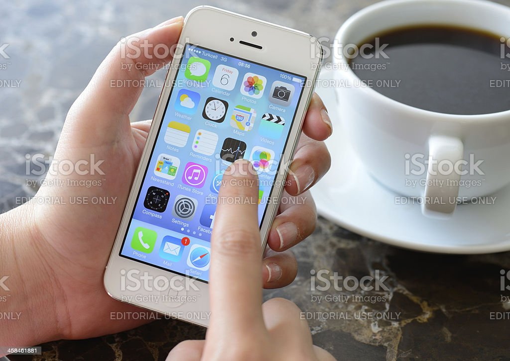 New Apple iOS 7  on iPhone 5 royalty-free stock photo
