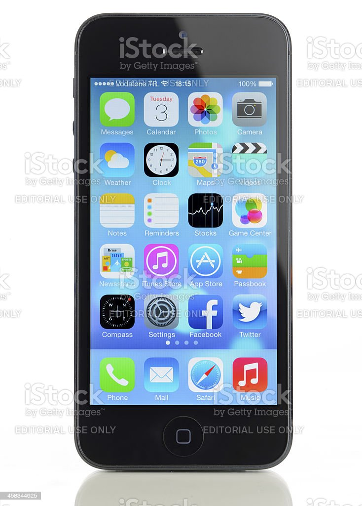 New Apple iOS 7 operating system on iPhone 5 royalty-free stock photo