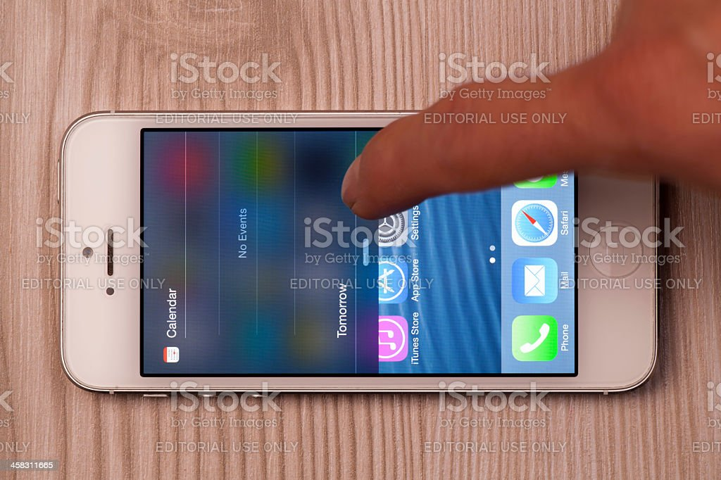 New Apple iOS 7 operating system on iPhone (English menu) royalty-free stock photo