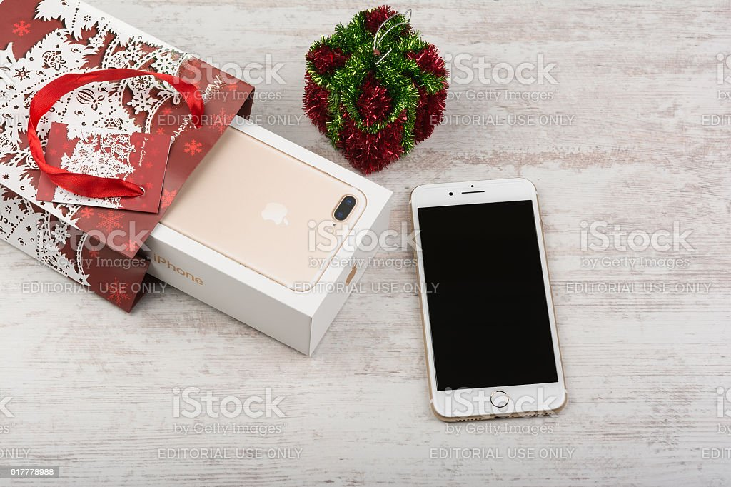 New Apple iPhone 7 Plus Gold, Christmas gift. stock photo
