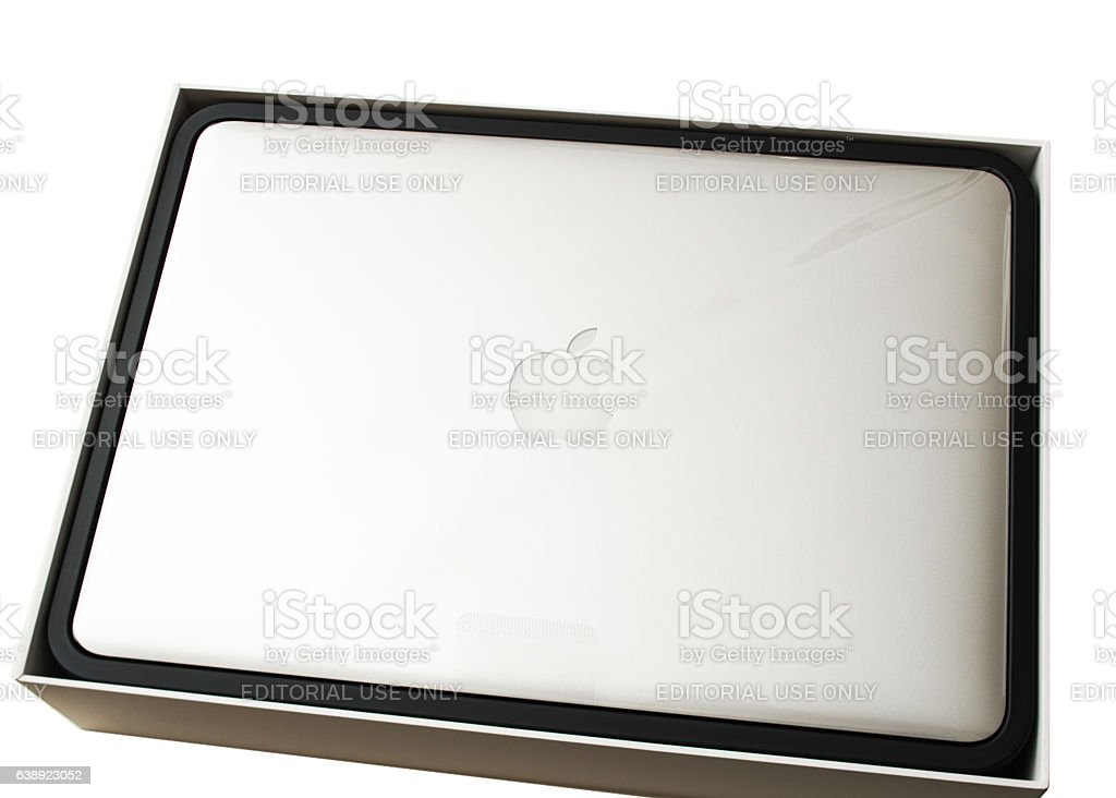 New Apple MacBook Pro laptop covered by the plastic film stock photo