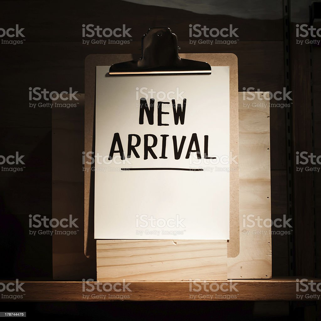 New arrival words written on clipboard royalty-free stock photo