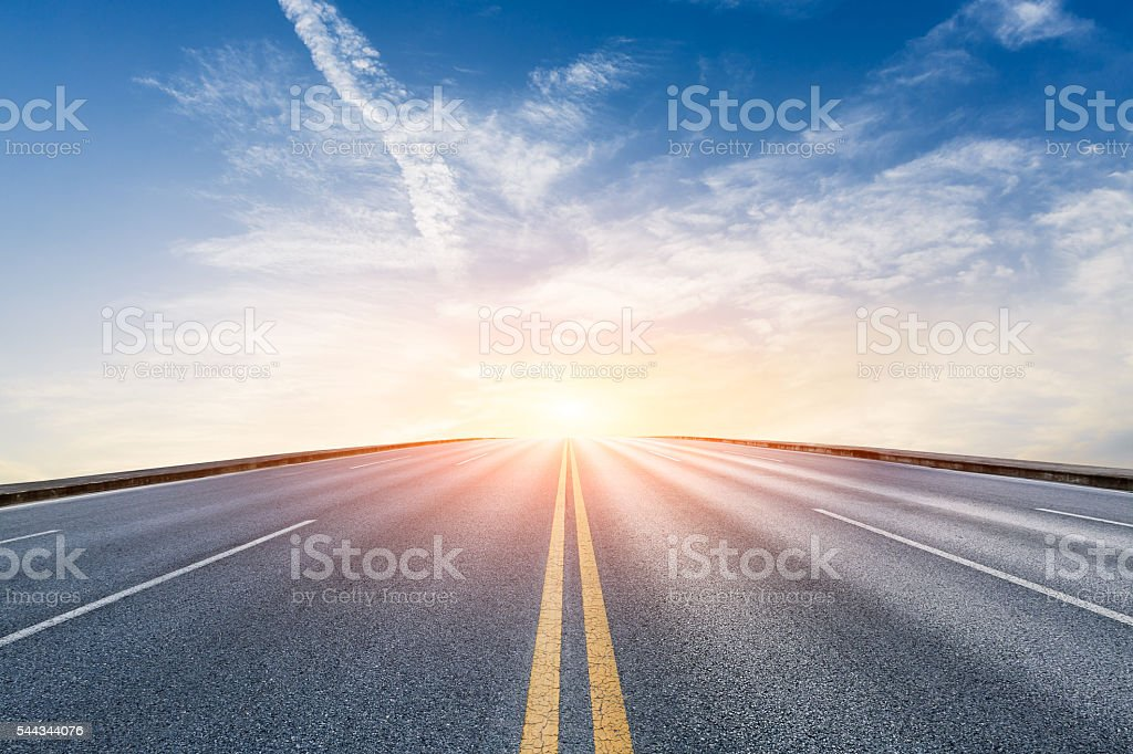 New asphalt highway scenery at sunset stock photo
