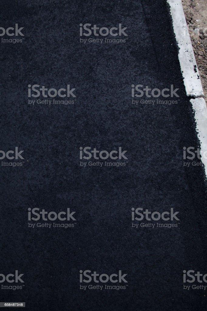 New asphalt on the road stock photo