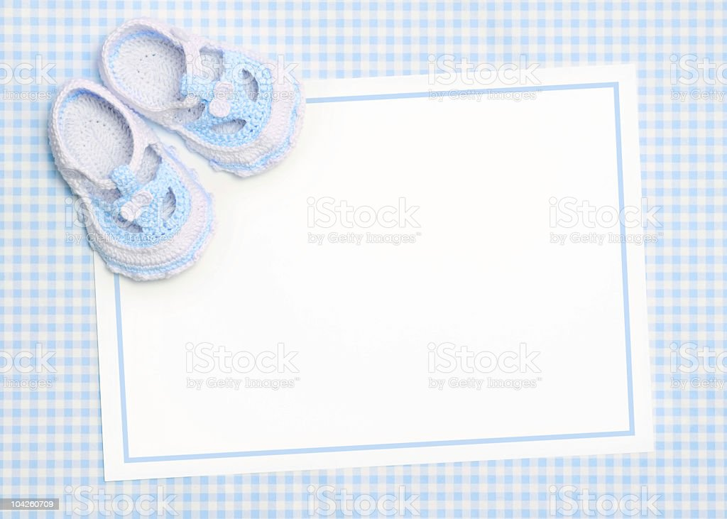 New baby boy announcement card with baby shoes in the corner stock photo