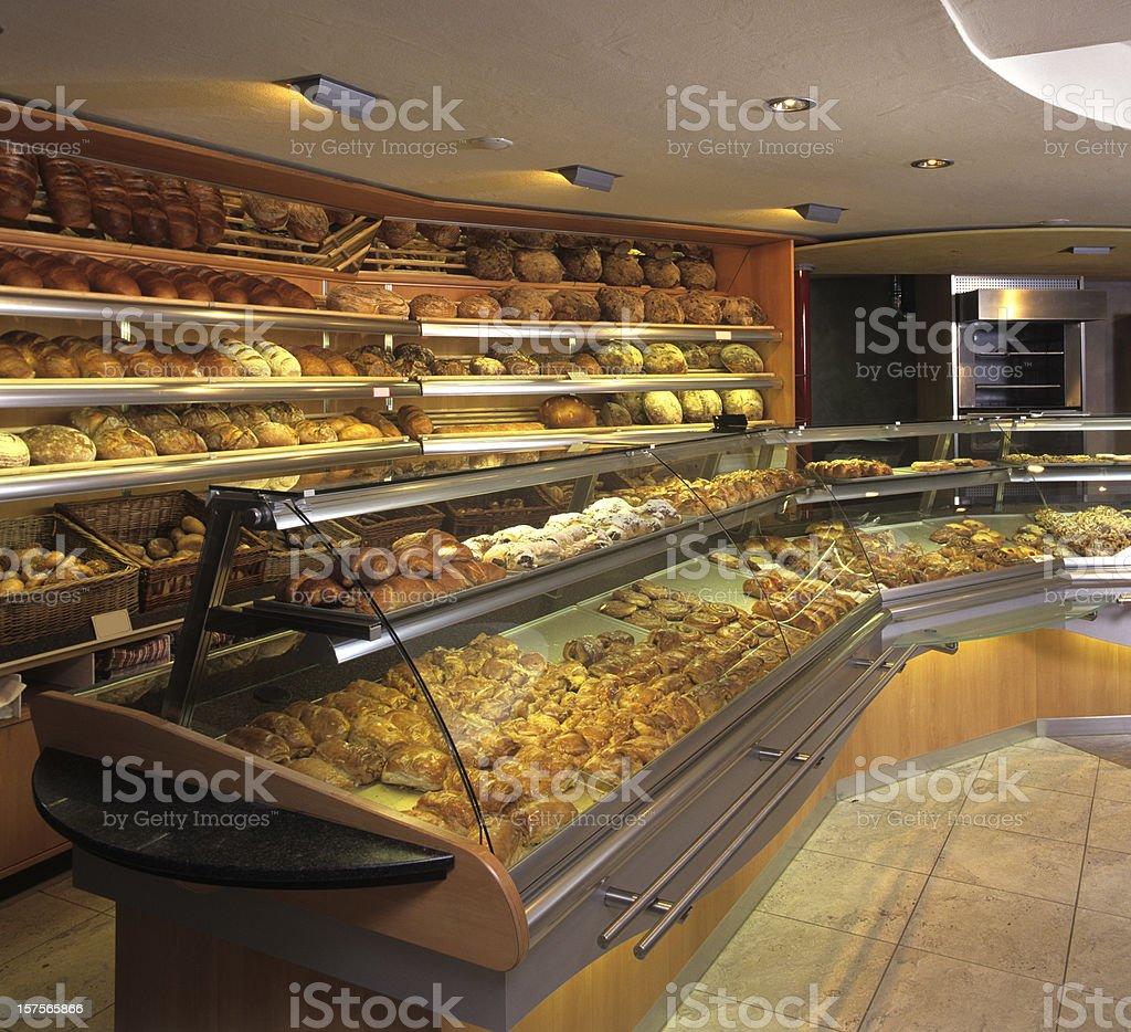 New bakery store indoor showing fresh baking goods stock photo